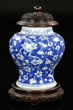 Blue and white porcelain jar, China, cracked ice and plum blossom decorated, with carved wood stand and cover.  From a private New England collection, purchased in the 1950s from Frank Caro, C.T. Loo's successor.