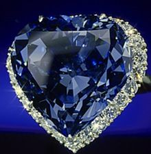 The Blue Heart diamond is 30.82 carats. The gem was cut into its distinctive shape in 1909-1910 and was bought by Cartier shortly thereafter. Since then it has bounced around from a wealthy Argentinian woman, Van Cleef and Arpels, a European family, Harry Winston, Marjorie Merriweather Post, and, finally, the Smithsonian, where The Blue Heart has resided since 1964.