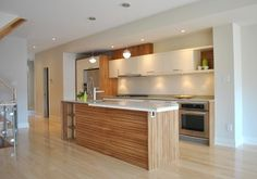 wood color adds color to the kitchen instead of fully white