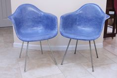 Pair of Blue Herman Miller Chairs designed by Eames by chairform, $1200.00