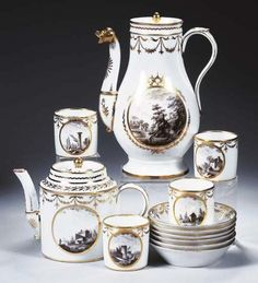 A Paris porcelain gilt coffee and teaservice  Circa 1785, probably Manufacture de Monsieur, Clignancourt  In the neoclassical style, gilt with garlands and stylised branches, finely painted en grisaille with Italianate landscape scenes within gilt medallions, comprising: a baluster coffee pot and cover with animal spout and loop handle, the slightly conical cover with ball finial, 24.5 cm. high; a cylindrical teapot and cover en suite, 15 cm. high; six cylindrical cups and saucers with loop…