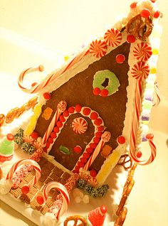 This gingerbread house reminds me of a spunky house that might be seen in whoville.  I love how the candy canes are place on the roof.