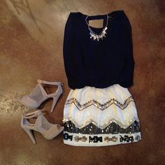 Awesome heels, dressy mini plain top with a collar necklace :)