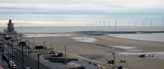 The view from the Lookout  on a grey overcast morning showing the Esplanade,the Beacon & the Turbine Wind-farm