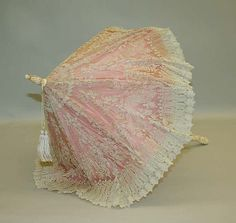 Pink French parasol with white lace overlay, circa 1880-1900