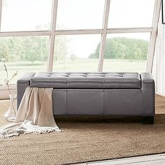 With smooth, grey faux leather upholstery and a hidden storage space that's perfect for storing blankets and throws, the Madison Park Mirage Storage Bench makes a great addition to any home. Sleek lines and wood legs provide an elegant profile.