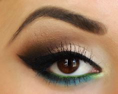 Cat eye style, while using the similar tones of the eye and bringing in the greenish blue, it really makes your eyes pop! Great for hazel eyes!