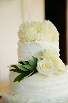 Simple white wedding cake with white flowers. So pretty!