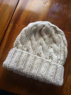 "This classic cable hat is perfect for any child. (Lion Brand Yarn)Free Pattern Bulky / 12 ply (7 wpi)  ?   22 stitches = 4"" in Cable Pattern  Needle size  US 9 - 5.5 mm 186 yards (170 m)  Sizes available  Finished Circumference 19 in. (48.5 cm)"