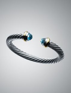 "7mm Color Classics Bracelet in Blue Topaz ($775 at DavidYurman.com)  ""David Yurman's iconic Cable bracelet—a twisted helix adorned with gemstones on its finial ends—inspires the vibrant Color Classics collection. These earrings, bracelets and rings pop in a palette of saturated hues."""