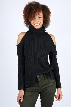 a111f109160a8 Two major trends come together in this Cold Shoulder Turtleneck Sweater.  Easily dress it down