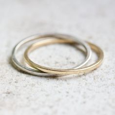 This interlocked ring consists of 2 bands made of sterling silver and brass. It is an original and modern piece, suitable for both a man or a woman. The ring would make a great gift symbolizing eterna