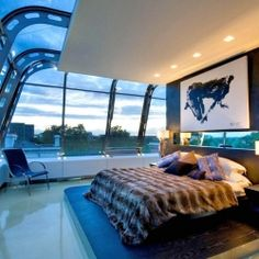 Breathtaking 8,000 square foot steel and glass penthouse sits at the top of two buildings connected by a glass bridge.