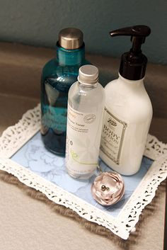 Vintage picture frame, spray painted white, with decorative scrap book paper = elegant bathroom tray :D