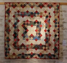 Quilts In The Barn A variation of a nine patch with a diagonal split