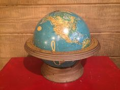 """Vintage Globe on set base. Very old and educational- plus it looks great! 17""""w x 15""""h x 17""""d"""