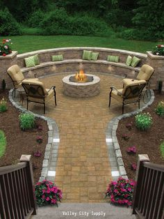A lovely patio with a raised brick fireplace and built in bench. See the difference between a patio and a deck.