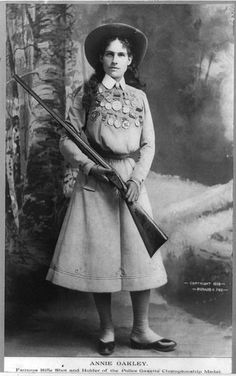 Full length photograph of Annie Oakley, noted American sharpshooter and show-woman, circa 1899. Image from Library of Congress online collection_Full_length_photograph_circa_1899.jpg/375px-Annie_Oakley_-_Full_length_photograph_circa_1899.jpg