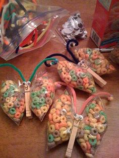 Edible butterflies. Simple craft using a ziplock bag, clothes pin, stick on eyes, a pipe cleaner cut in half and a handful of fruitloops.