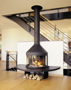Wood-burning fireplace / closed hearth / contemporary OPTIFOCUS Focus