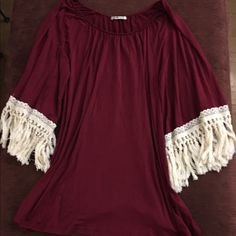 Maroon tunic top with beautiful knit bell cuffs. Nwot, never worn. There's no size tag but can fit most sizes. Can be a dress, tunic or top. Tops