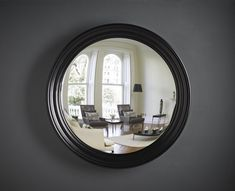 Handcrafted and hand finished this handsome round wall mirror will add a timeless element to your home decor.   Perfect for hanging above a fireplace, over a hall table or in a study. Opt for a black finish against dark grey or inky blue walls for an atmospheric, masculine scheme.  #largeroundwallmirror #largeroundmirror #blackmirror #fireplacemirror #wallmirror #hallwaymirror Stone Fireplace Makeover, Fireplace Mirror, Fireplace Ideas, Hallway Mirror, Convex Mirror, Extra Large Round Mirror, Purple Rooms, Chimney Breast, Beautiful Mirrors