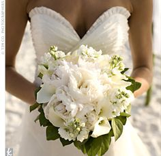 Tracee carried a lush bouquet of white peonies, calla lilies and stock. Her favorite part of the bouquet was a handkerchief with the initials of all the women in Colby's family who had carried it before her.