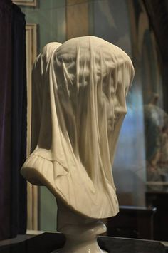 The Veiled Virgin This statue was executed in flawless Carrera marble by the renowned Italian sculptor Giovanni Strazza (1818-1875) in Rome.