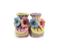 knitted baby booties with crochet bell flowers