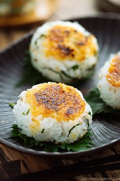 Sweet savory miso sauce slathered on warm fluffy rice balls this Miso Yaki Onigiri Japanese grilled rice balls is perfect for a summer picnic afternoon snack for your children or midnight treat for yourself Easy Japanese Recipes at Easy Japanese Recipes, Asian Recipes, Japanese Food, Kale Recipes, Japanese Dishes, Sushi, Savory Snacks, Healthy Snacks, Grilling Recipes