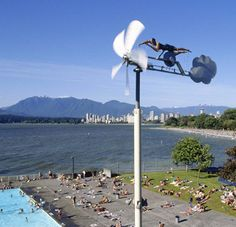 Kitsilano Pool Wind Swimmer -  The Wind Swimmer sculpture by artist Doug Taylor was inspired by the artist's meeting with an older man who swam regularly off Stanley Park. The prototype was made in 1993 for the Artropolis exhibition and installed in Stanley Park, but it was smashed by a log.  The current Wind Swimmer sculpture was installed at Kits Beach in 1996. At winds of more than 55mph, it turns sideways and slows down.