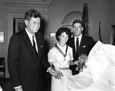 JFK, Miller, Dammit, and Najeeb Halaby (Administrator of the FAA) pose for one final photo.