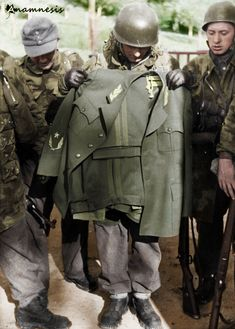 Having narrowly failed to capture the Yugoslav partisan leader during Operation Knights Move these German Waffen-SS paratroopers hold up Titos captured uniform 1944