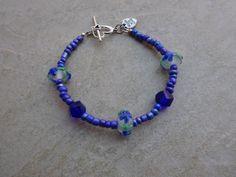Blue Flower Lampwork Beaded Bracelet by MadeInTheFalls on Etsy