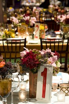 TableArt- Bat Mitzvah- Farm stand tablescapes. Metal table numbers. {Venue: Reading Terminal Market}