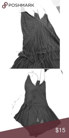 Grey romper Embellished boarder. Thin, patterned grey. Draw string waist. Tasseled rope tie. Loose fitting bottom. Racer back, thin, rope straps. Urban Outfitters Dresses Backless