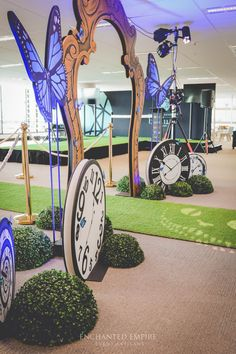 Alice in Wonderland's Through the Looking Glass was the perfect theme for the Academy of Beauty's Launch night. A custom entrance consisting of a golden mirror framed arbour, clocks and beautiful blue butterflies. Guests were lead through the arbour on a plush grass runner with a cheeky Cheshire cat light projection towards the cascading and trailing Mad Hatter's Lolly Buffet. Moss and bright florals, complimented the bright candy that was accented by chocolate bars and coloured popcorn…