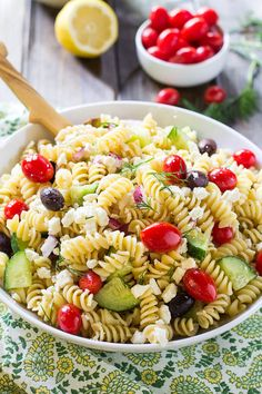 1 pound fusilli pasta 1-2 tablespoons salt ⅓ cup red wine vinegar 1 TBSN lemon juice 1 tsp garlic powder 1 tsp sugar ½ teaspoon dried oregano ¼ teaspoon salt ¼ teaspoon ground black pepper ½ cup olive oil 1 tablespoon oil from sun-dried tomatoes  ½ red onion, finely diced 1 pint cherry or grape tomatoes ¾ cup kalamata olives ½ large cucumber, diced 2 tablespoons chopped sun-dried tomatoes packed in oil 1 cup crumbled feta cheese 2 tablespoons chopped fresh dill  pepperoncini (optional)