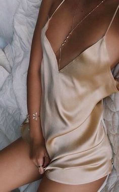 Sexy little gold slip dress. She looks incredible