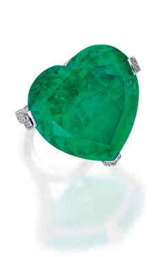 *18 KARAT WHITE GOLD, EMERALD AND DIAMOND RING, REPOSSI, FRANCE The heart-shaped emerald weighing approximately 50.00 carats, the mounting set with round diamonds weighing approximately 2.15 carats,  fitted with inner sizing band, with French assay and maker's marks.