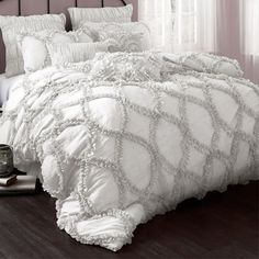 Highlighted by ruffled details, this chic comforter set offers textural appeal for your master suite or guest room.   Product: 1 Que...