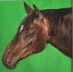 Wool portrait of a horse on green felt