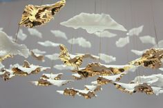 Leaf is a delicate hanging sculpture comprising of slip-cast bone china leaves with a 14 Karat gold lustre. Each leaf… Interior Lighting, Lighting Design, Industrial Lighting, Ceiling Lamp, Ceiling Lights, Light Installation, Hanging Art, Ceiling Design, Light And Shadow