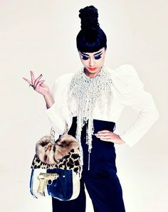 Picture of Natalia Kills, i love her modern hair and make up style that remindes me of audry hepburn