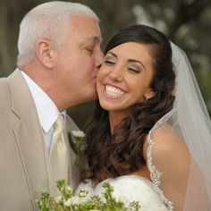 Liz is all smiles as Dad gives her an adoring kiss on the cheek.