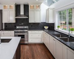 white-hanging-cabinet-finish-patterned-black-granite-countertop - OutOfHome