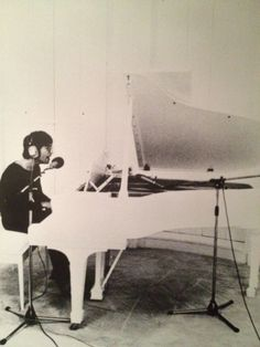 Ben Stiller ‏ @RedHourBen    Cool photo of John Lennon. I imagine he is recording Imagine.