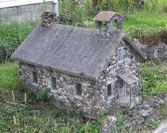 Beautiful doll size stone house in a garden