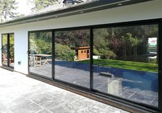 Stunning EdgeGlide Doors for Surrey home | Exact Architectural Glazing