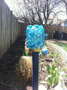 diy garden art, crafts, gardening, And then screwed the jar onto the lid Not only does it shimmer in the sunlight it gives off a soft blue glistening glow at night thanks to the solar light inside Should the light quit working I can simple untwist it and replace the battery in the light